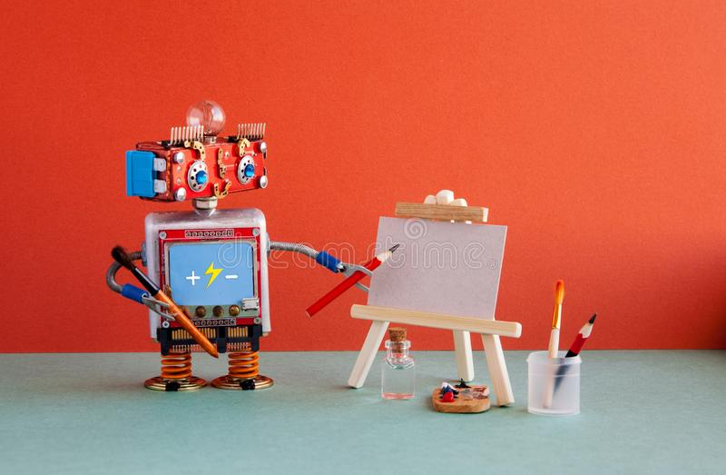 Kindly robot artist begins to create a drawing with a pencil. White paper template, wooden easel and artist`s tools. Palette, pencils case. Red wall background stock images
