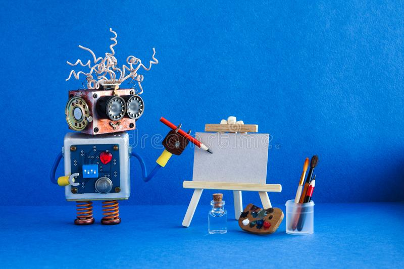 Kindly robot artist begins to create a drawing with a pencil. White paper template, wooden easel and artist`s tools. Palette, pencils case. Advertising poster royalty free stock photo