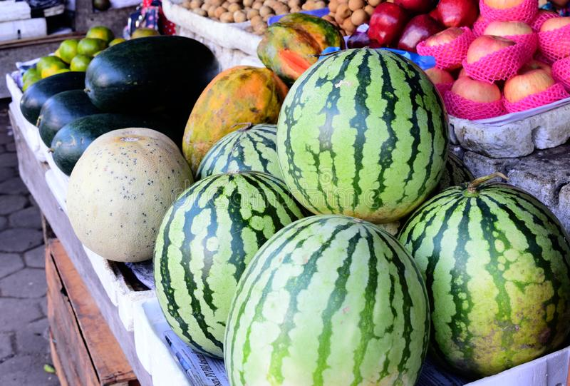 Kinds of fresh fruit sold on the market, fresh fruit on the market. watermelon, apples, papaya fruit. fresh fruit. royalty free stock photography