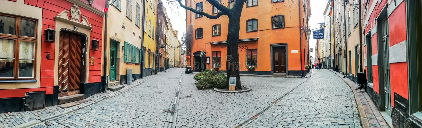 Kindstugatan square, Stadsholmen island, Gamla Stan district, Stockholm, Sweden. Panoramic view of Kindstugatan square, with a chestnut tree at the center royalty free stock photo