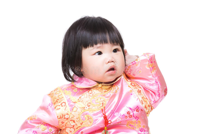 Kines behandla som ett barn flickaskrapahuvudet arkivbild