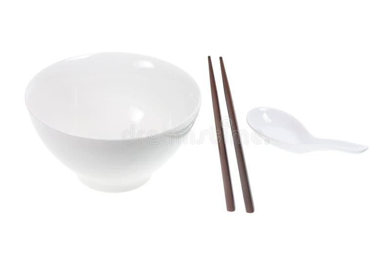 kines som äter utensils arkivfoton