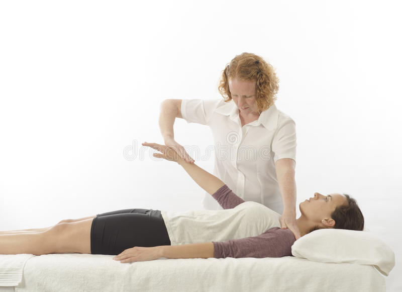 Kinesiologist Treating Anterior Deltoid Stock Images