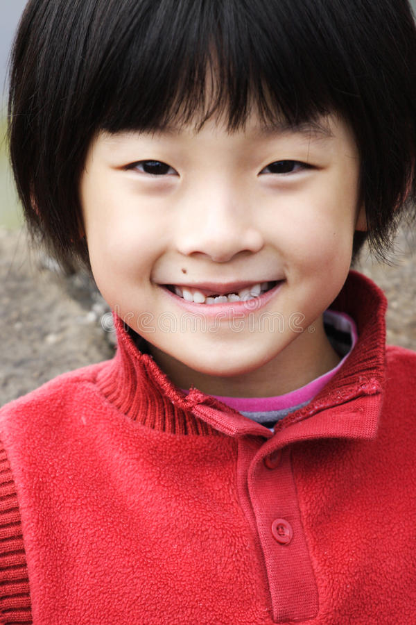 kinesisk flicka little som ler royaltyfria foton