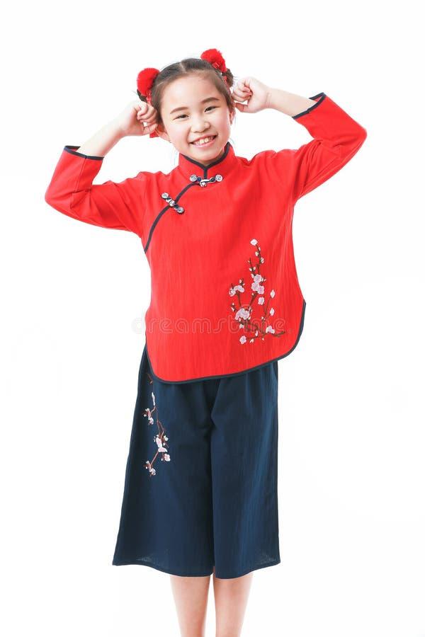 Kinesisk flicka p? vit bakgrund fotografering för bildbyråer