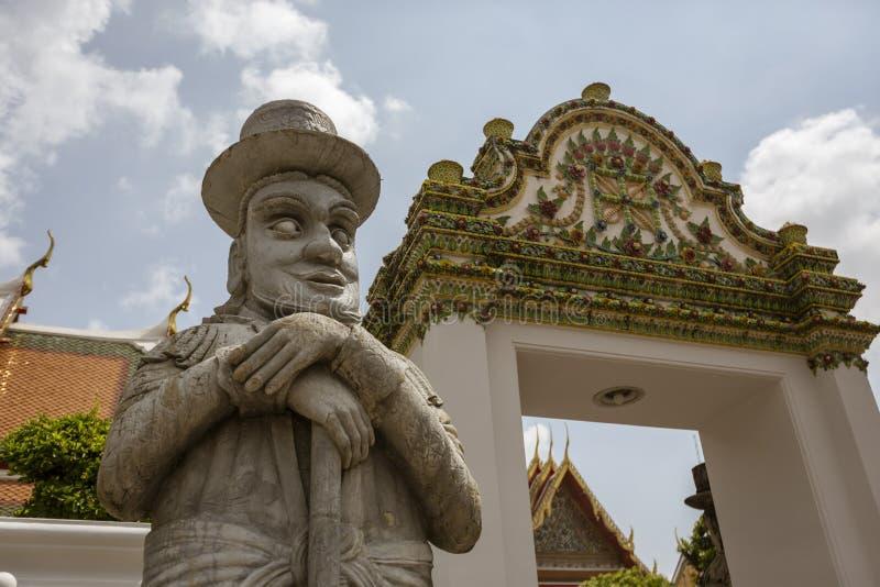Kinesisk krigarestaty på Wat Pho Temple i Bangkok, Thailand arkivbild