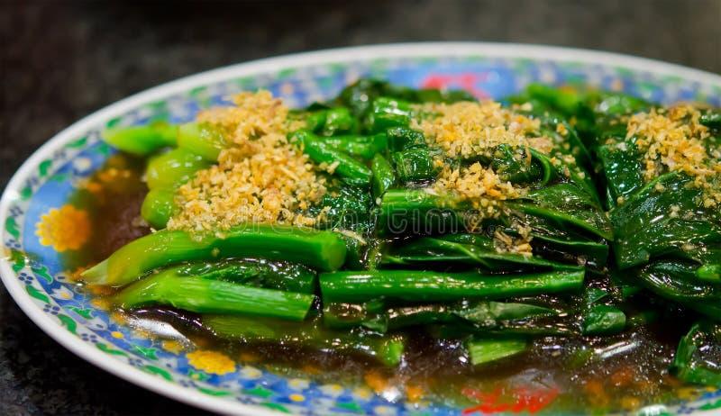 kinesisk stekt grön senapsgultt stir royaltyfri fotografi