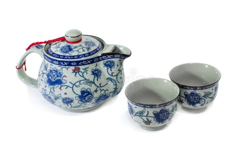 Kinesisk teaupps?ttning p? vitbakgrund arkivfoto