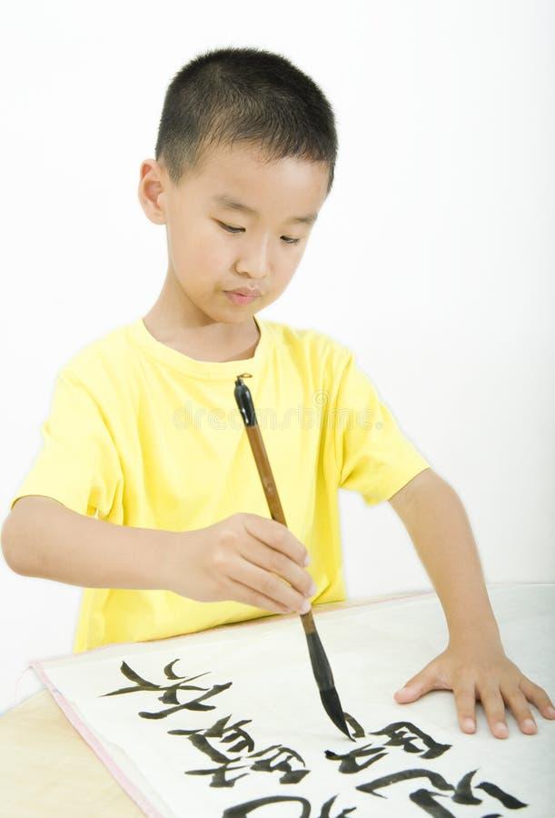 kinesisk writing för calligraphybarn arkivbilder