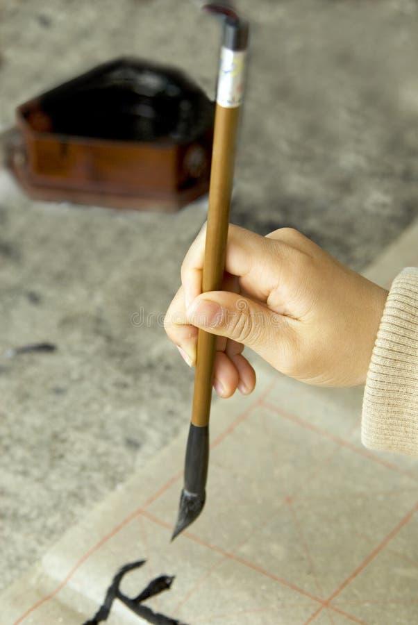 kinesisk writing för calligraphybarn royaltyfri foto