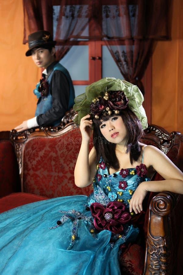 kinesiska par i retro stil arkivfoton