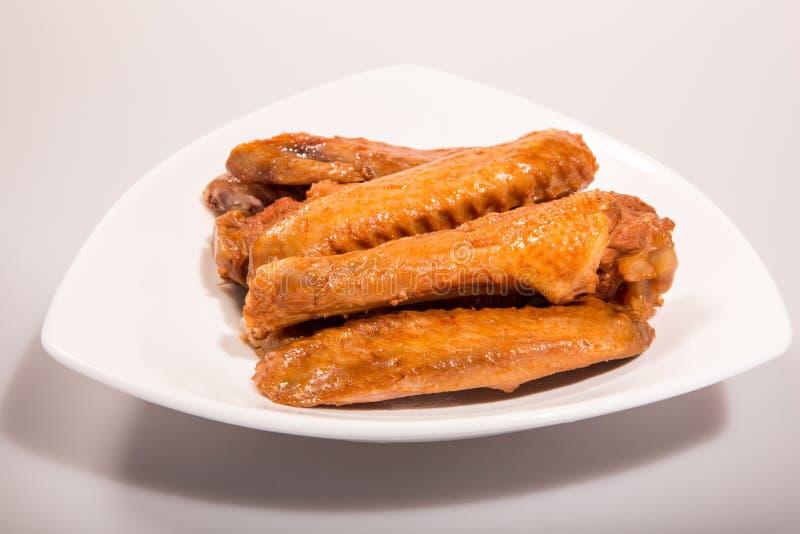 Kinesiskt kött - kryddade andvingar arkivbilder