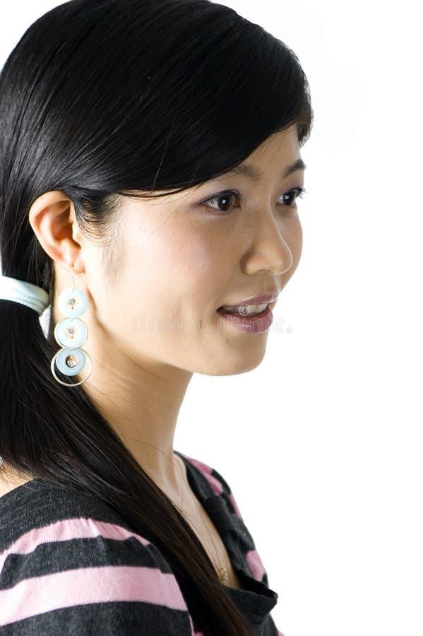 kinesiskt le för flickastående arkivbilder