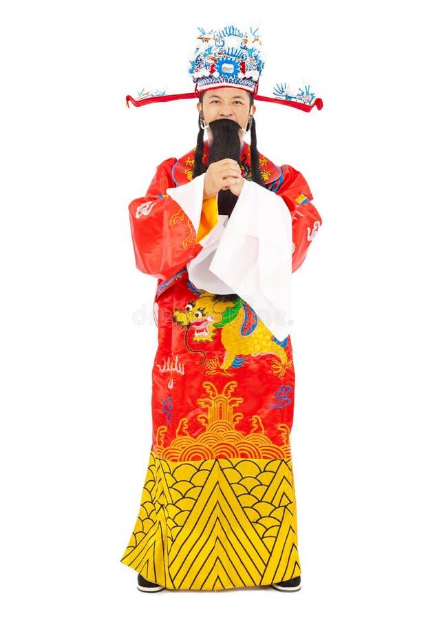 Kinesiskt nytt år! guden av rikedom gör en hälsninggest royaltyfri bild