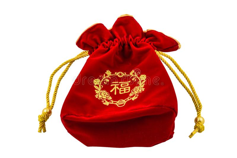 Kinesiskt rött tyg för nytt år eller siden- påse, ang-pow av lyckaisolat royaltyfri foto