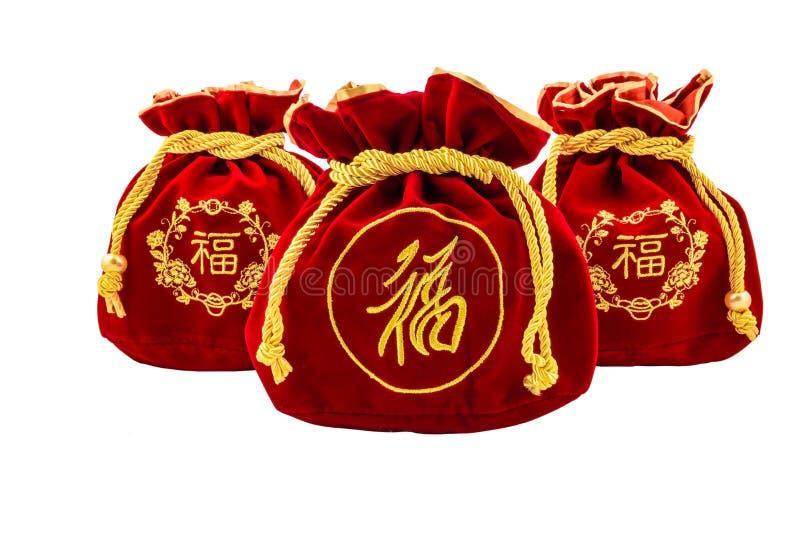 Kinesiskt rött tyg för nytt år eller siden- påse, ang-pow av lyckaisolat arkivbild