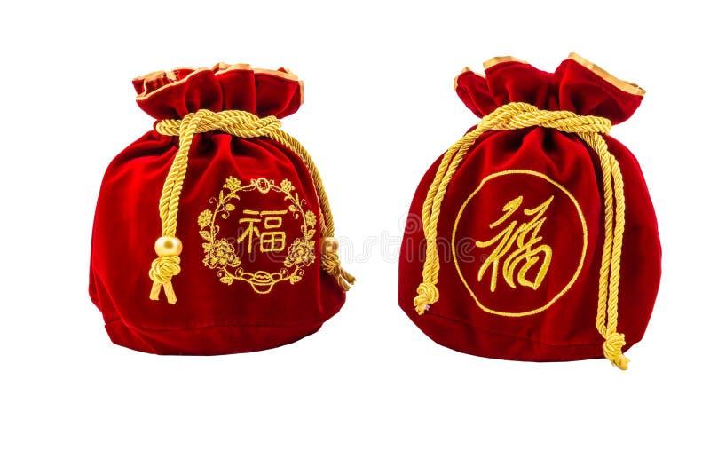 Kinesiskt rött tyg för nytt år eller siden- påse, ang-pow av lyckaisolat royaltyfri bild