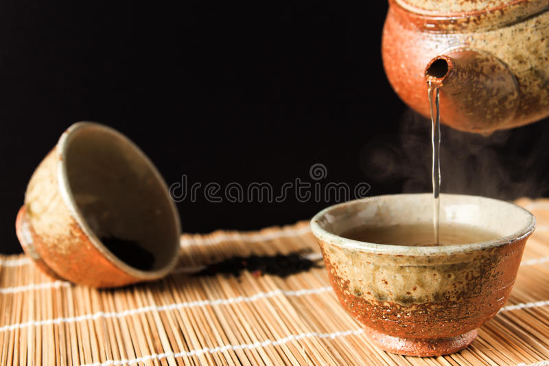 Kinesiskt te fotografering för bildbyråer