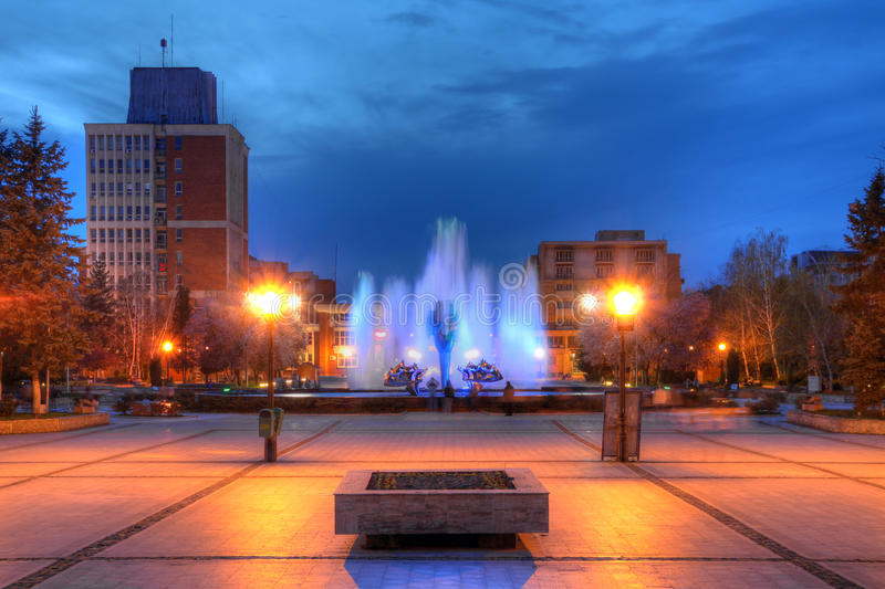 Kinetic fountain in downtown Resita, Romania. A beautiful kinetic fountain stands in the middle of the central square (Square December 1st 1918) of Resita a city stock photo