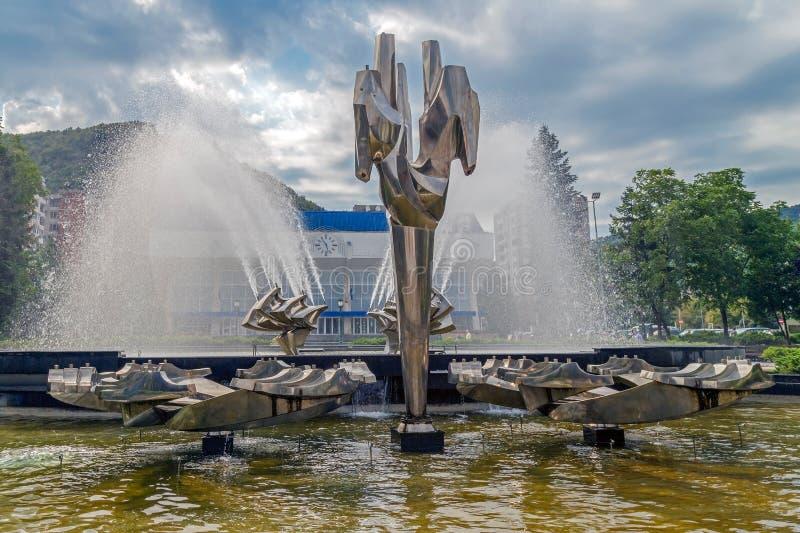Kinetic fountain located in the central square of Resita, Romania. RESITA, ROMANIA - SEPTEMBER 1, 2016: Kinetic fountain located in the central square of Resita stock image
