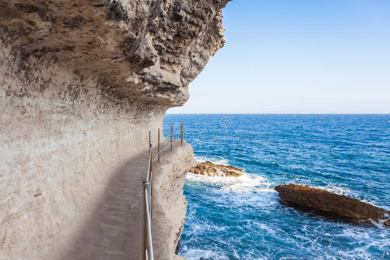 King Aragon stairs steps in Bonifacio cliff coast rocks, Corsic. King Aragon stair steps in Bonifacio cliff coast rocks, Corsica island, France royalty free stock image