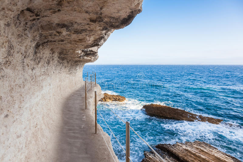 King Aragon stairs steps in Bonifacio cliff coast rocks, Corsic. King Aragon stair steps in Bonifacio cliff coast rocks, Corsica island, France stock images