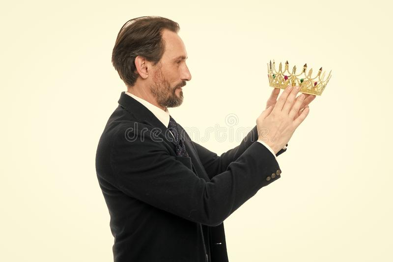 King attribute. Become next king. Monarchy family traditions. Man nature bearded guy in suit hold golden crown symbol of. Monarchy. Direct line to throne royalty free stock photo