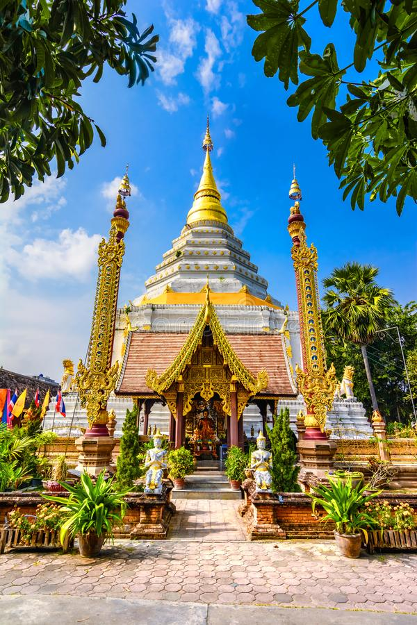 King Bumibhol stands in front of the white Chedi at Wat Chang Yuen,Thailand, Chiang Mai. Chiang Mai, Thailand: A photograph of King Bumibhol stands in front of stock photography