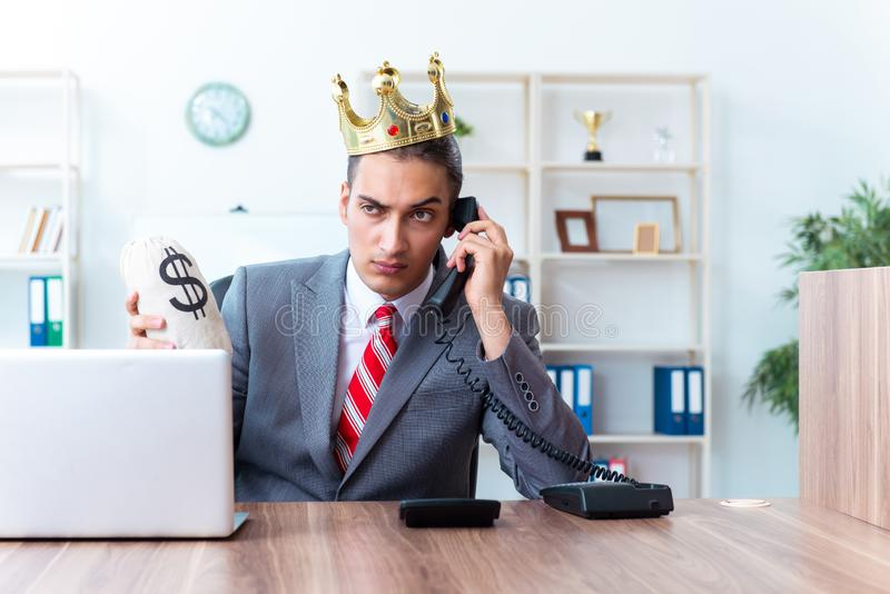 King businessman at his workplace royalty free stock photography