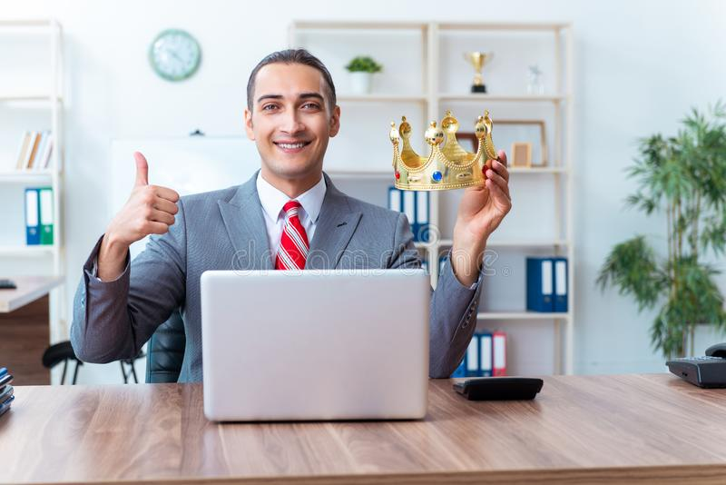 King businessman at his workplace stock image