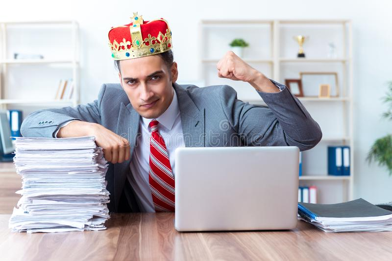 King businessman at his workplace royalty free stock photos