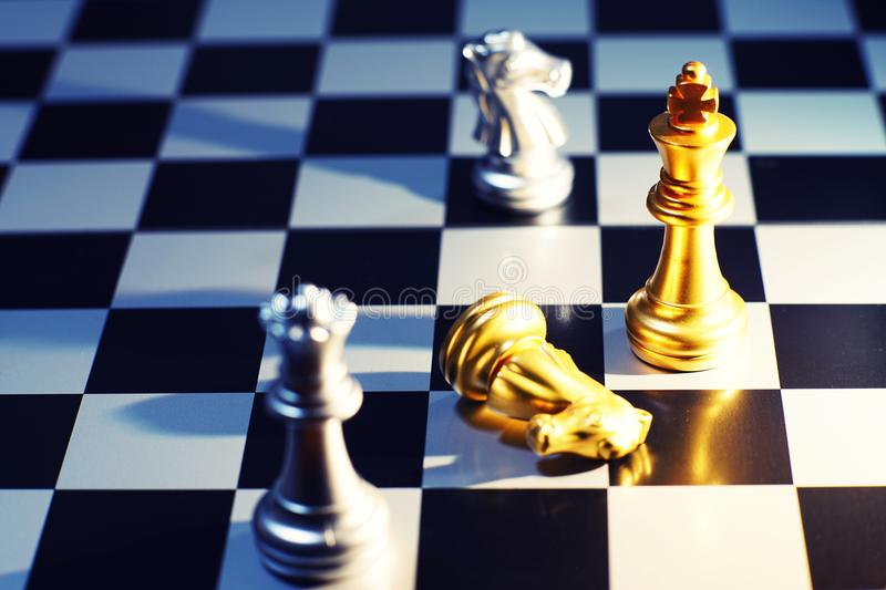 The king in chess game battle of chessboard surrender by knight and queen checkmate, business strategy concept, competitive advent stock photography