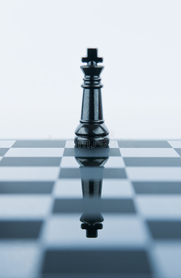 King chess piece reflected in chessboard. Against white background stock images