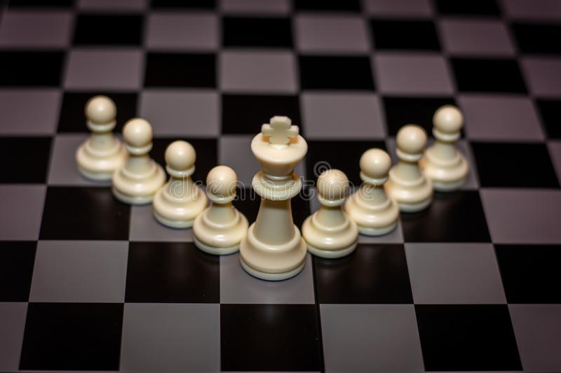 King chess piece stand in front of pawn Concept of leadership, management stock image