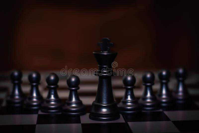 King chess piece stand in front of pawn Concept of leadership, management stock photos