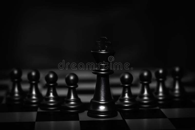King chess piece stand in front of pawn Concept of leadership, management stock images