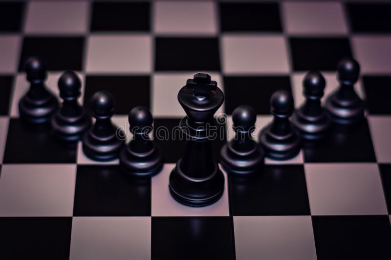 King chess piece stand in front of pawn Concept of leadership, management royalty free stock photos