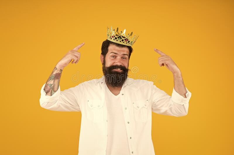 King crown. Love yourself. Holiday carnival celebration. brutal guy prince yellow background. King of party. Egoist. Selfish man. Superstar concept. Royal royalty free stock image