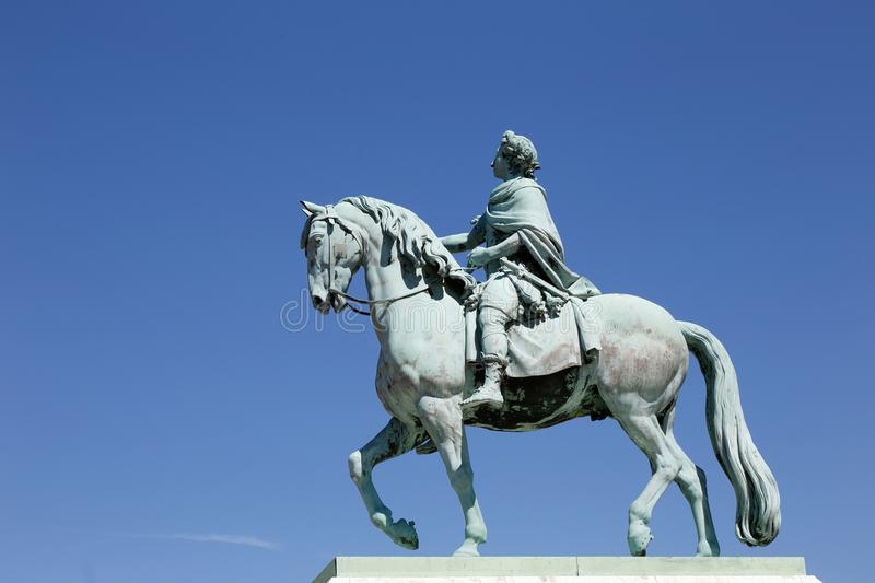King Frederik V on horseback. Danish king Frederik V of Denmark and Norway 31 March 1723 - 14 January 1766 on horseback bronze sculpture at Amalienborg palace stock images
