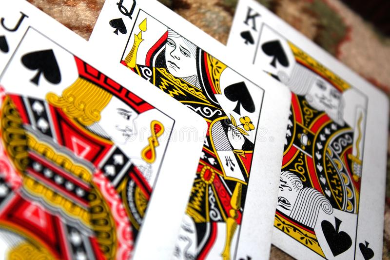 King, Jack, And Queen Of Spades Playing Cards royalty free stock photography