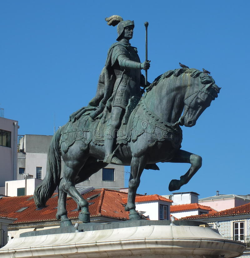 King John I of Portugal. In Figueira Square, Lisbon, stands a statue of King John I of Portugal. It was erected in 1971. cast in bronze and is the work of stock images