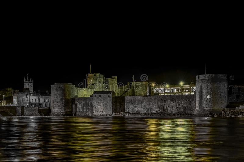 King John`s Castle celebrates St Patrick. King John`s Castle is a 13th-century castle located on King`s Island in Limerick, Ireland, next to the River Shannon royalty free stock photos