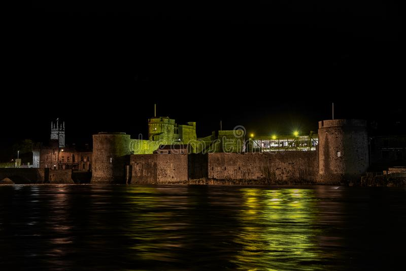 King John`s Castle celebrates St Patrick. King John`s Castle is a 13th-century castle located on King`s Island in Limerick, Ireland, next to the River Shannon royalty free stock photo