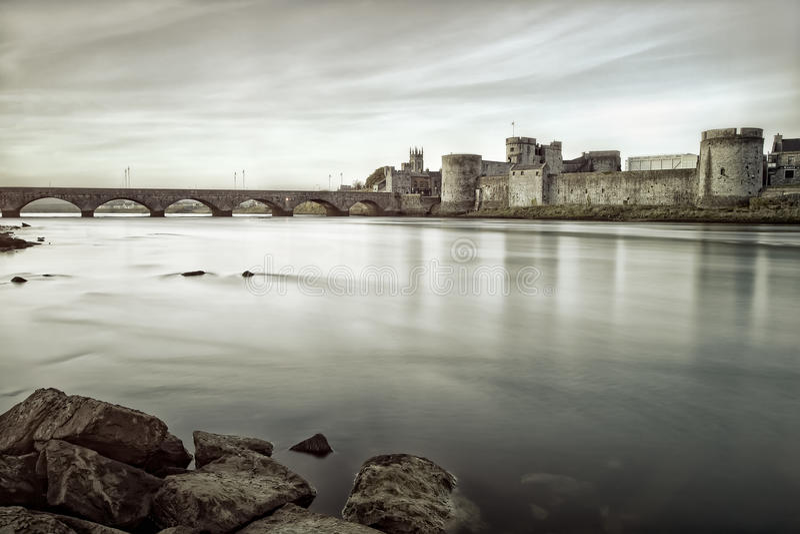 King John's Castle in Limerick, Ireland.B&w photo. King John's Castle is a castle located on King's Island in Limerick, Ireland, next to the River Shannon.Black stock photo