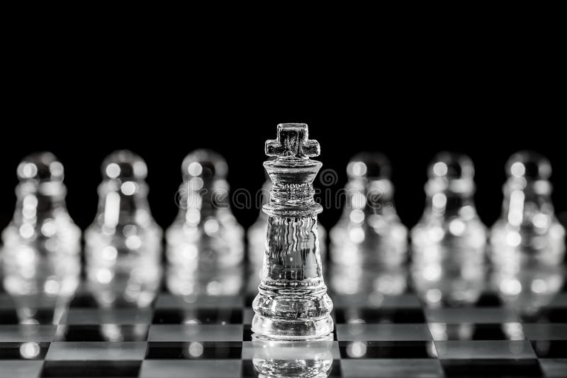 King. The king moves one square in any direction. The king has also a special move which is called castling and involves also moving a rook royalty free stock photography