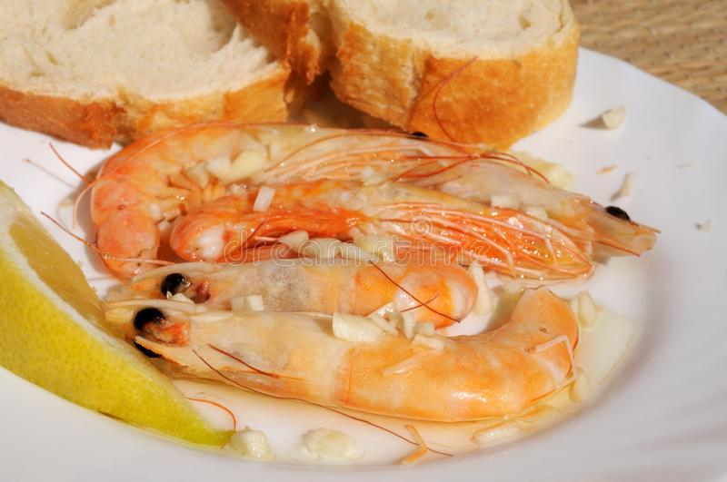 Download Prawns In Garlic With Bread. Stock Photo - Image of whole, lemon: 29823724