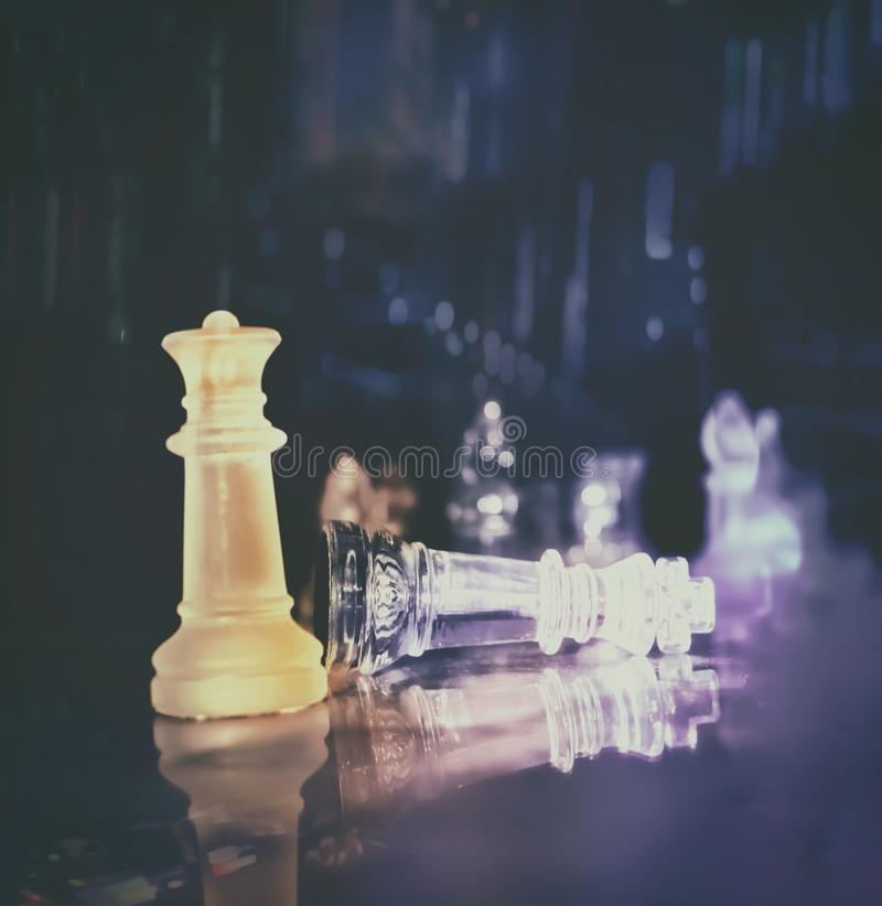 A king and queen chess piece on a glass. Checkmate. Challenge, leadership and competition concept royalty free stock photos