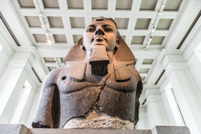 King Ramesses II. King Ramesses the second. The upper part of a colossal seated statue. Many of his colossi and their own name and were a focus for prayers stock image