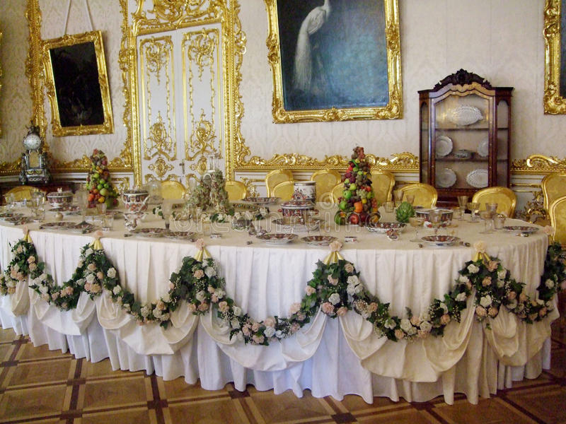 Saint Peterburg, Russia - JUNE 12, 2013: King s banquet dining Table setting in the palace. King`s dining Table setting in the palace. Saint Peterburg stock photography