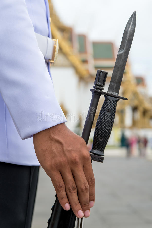 King's Guards on duty. A member of the King's Guards on duty with a rifle and bayonet, Bangkok, Thailand stock photos